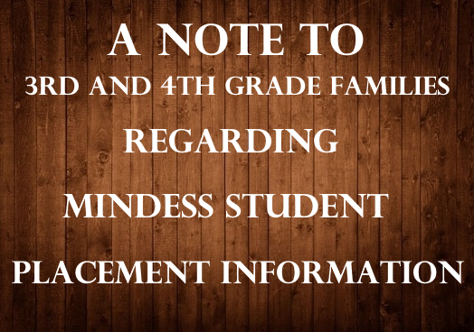 Wood background with lettering to grade 3 and  4 families about student placement for 2021/2022